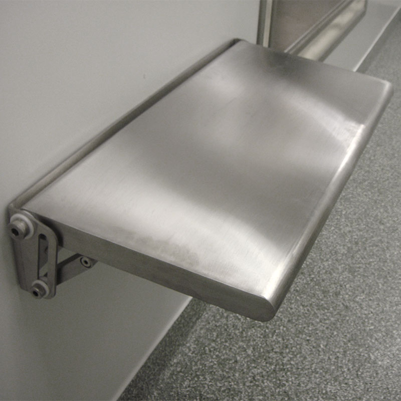 KryptoMax® Stainless Steel Fold-Up Wall Desk installed in a room on wall, folded down and ready to be used as work station