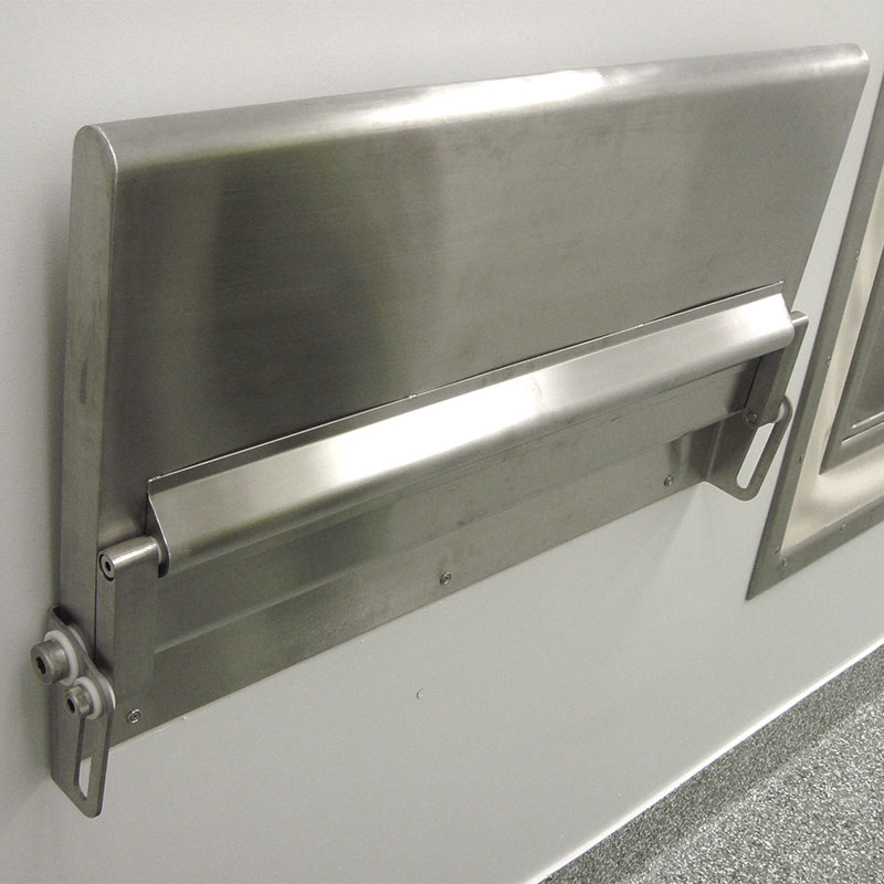 KryptoMax® Stainless Steel Fold-Up Wall Desk shown installed on wall in room and folded up for storage