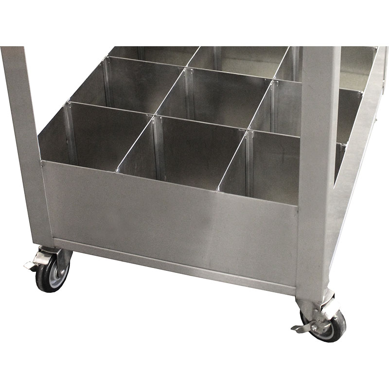 Close-up view of the base with locking swivel casters on the KryptoMax® Stainless Steel Corrections Kitchen Utility Cart